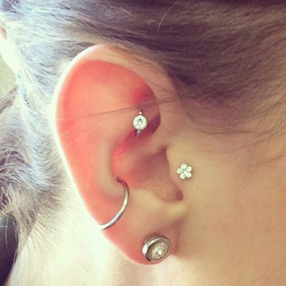 Conch tragus hook piercing