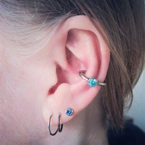 conch piercing azul bolinha