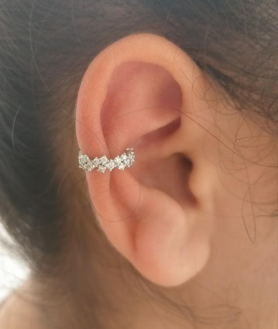 conch piercing estilizado
