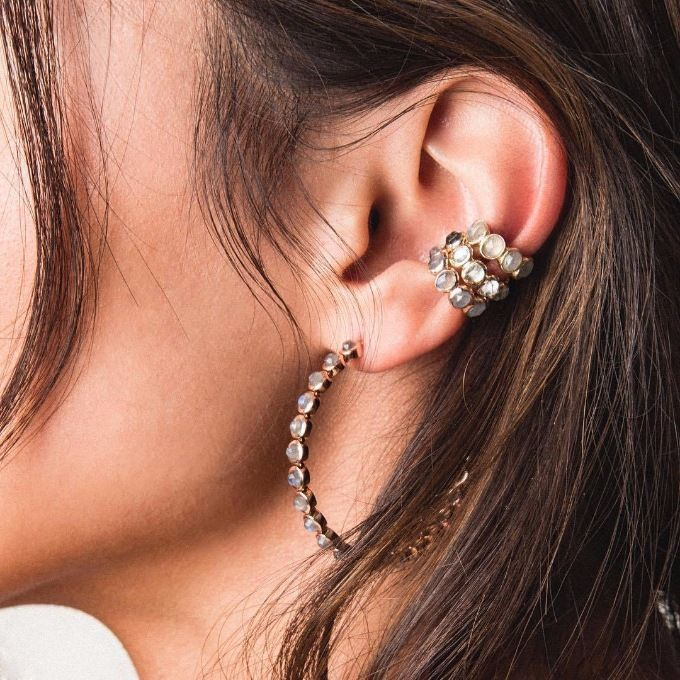 conch piercing triplo