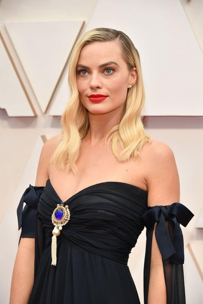Broche de Margot Robbie no Oscar 2020